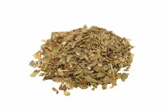 Pile of dried oregano leaves on white Stock Images