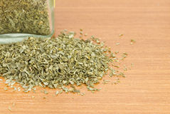 Pile of dried parsley with glass jar Royalty Free Stock Images