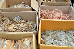 Pile of dried seafood in packed paper box Royalty Free Stock Photos