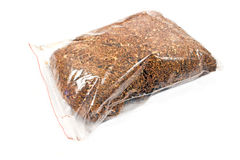 Pile of dried tobacco in plastic bag Royalty Free Stock Image