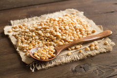Pile of dried yellow peas with a spoon Royalty Free Stock Image