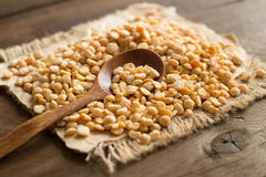 Pile of dried yellow peas with a spoon Royalty Free Stock Photography