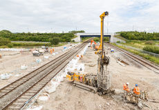 Pile drilling machine, on site next to a section of railway track. Stock Photos