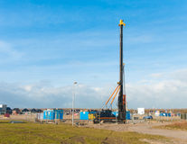 Pile driver. In a newly build residential area Stock Photo