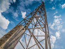 Pile driver with clouds and sky Stock Photography