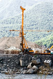 Pile driver at a construction. Drilling rig on site bore hole on the river Stock Image