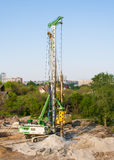 Pile driver at a construction site Stock Images