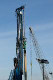 Pile driver and crane. Royalty Free Stock Photos
