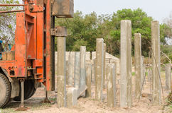 Pile driver driving precast concrete pile  Royalty Free Stock Images
