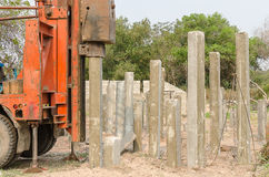 Pile driver driving precast concrete pile Royalty Free Stock Photo