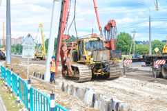 Pile driver works to set precast concrete piles for repair road Stock Photo