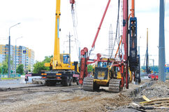 Pile driver works to set precast concrete piles for repair road Royalty Free Stock Image