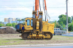 Pile driver works to set precast concrete piles for repair road Royalty Free Stock Images