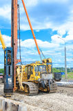 Pile driver works to set precast concrete piles for repair road Stock Photos