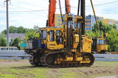 Pile driver works to set precast concrete piles for repair road Royalty Free Stock Photos
