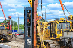 Pile driver works to set precast concrete piles for repair road Royalty Free Stock Photography