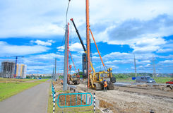 Pile driver works to set precast concrete piles for repair road Royalty Free Stock Photo