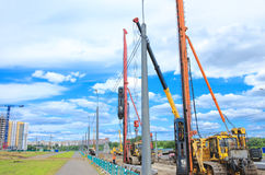 Pile driver works to set precast concrete piles for repair road Stock Photography