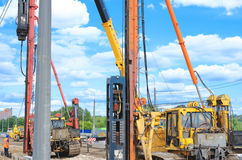 Pile driver works to set precast concrete piles for repair road Stock Images