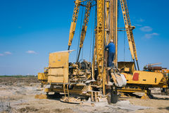 Pile driving machine in construction site Stock Photography