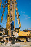 Pile driving machine in construction site Stock Photos