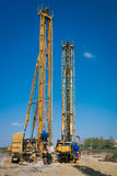 Pile driving machine in construction site Stock Image