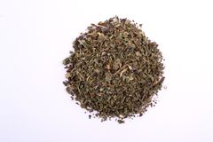 Pile of dry basil. Top view of a portion herbs seasoning isolated. On a white background Stock Photography
