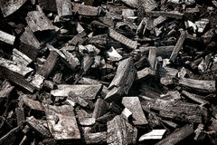 Pile of Dry Burned Hardwood Wood Charcoal. Pile of burned and blackened dry wood charcoal made of tree logs and hardwood pieces cut and slowly heated with Royalty Free Stock Photo