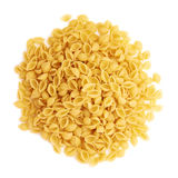 Pile of dry conchiglie pasta over isolated white background Stock Photos