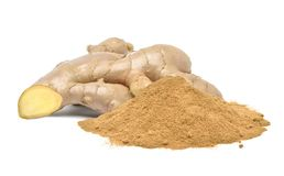 Pile of dry finely ground ginger powder with fresh ginger rhizome root Royalty Free Stock Photo
