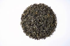 A pile of dry green tea. Isolated on white background. Food background. Royalty Free Stock Photo