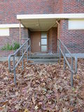 Pile of dry leaves. In front of the entrance stock photography