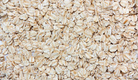 Pile of dry oat flakes, evenly layer background. 