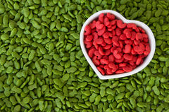 Pile of dry pet food with red color in heart cup , love pet concept. Pile of dry pet food with red color in heart shape cup , love pet concept Stock Image