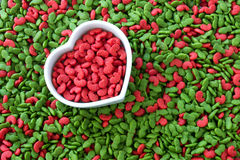 Pile of dry pet food with red color in heart cup , love pet concept. Pile of dry pet food with red color in heart shape cup , love pet concept Stock Photography