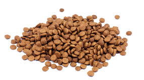 Pile of dry pet food on white background Stock Images