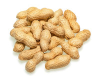 Pile of dry roasted peanuts isolated on white background. Royalty Free Stock Images