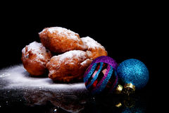 Pile of Dutch oliebollen and Christmas balls Stock Photography