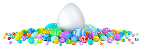 Pile of Easter eggs surrounding a giant white egg. Pile of colorful Easter eggs surrounding a giant white egg Royalty Free Stock Image