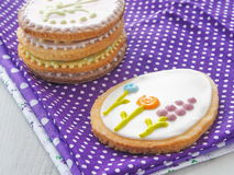 Pile of Easter sugar cookies glazed with royal icing. Stock Photos