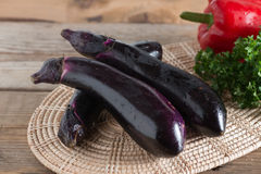 Pile Eggplant on wood table. Stock Image