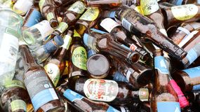 A pile of empty beer bottles royalty free stock photos