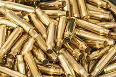 Pile of empty bullet shells Stock Photo