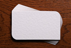 Pile of empty business cards on wood background Royalty Free Stock Images