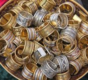 Pile ethnic rings sold at local market Stock Photo