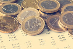 Pile of Euro coin on financial document Royalty Free Stock Photography
