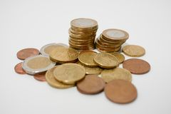 Pile of Euro coins of various denominations on a white desk, shallow depth of field stock photos
