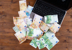 Pile of euro money with Laptop royalty free stock images