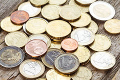 Pile of European currency coins. On the wooden background Royalty Free Stock Photos