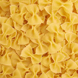 Pile of farfalle yellow pasta as abstract background Royalty Free Stock Photos